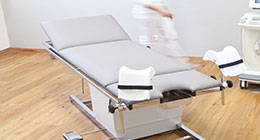 Multi-function examination tables and accessories